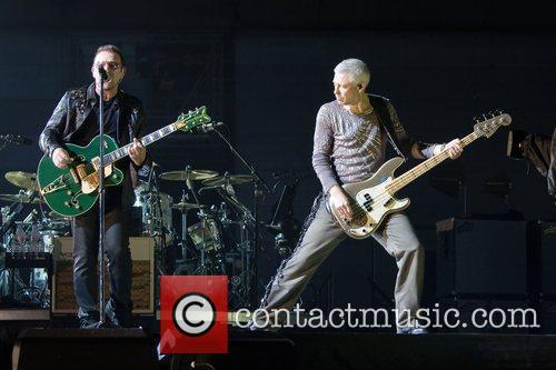 Bono and Adam Clayton U2 performing live at...