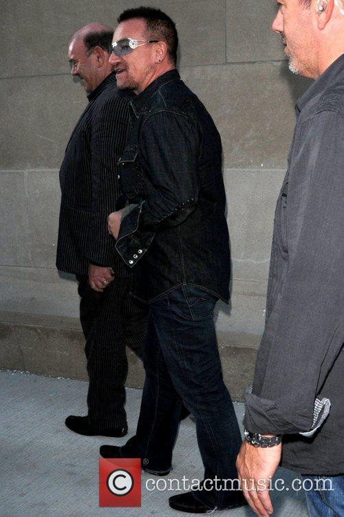 Band members of U2 leaving MTV studios at...