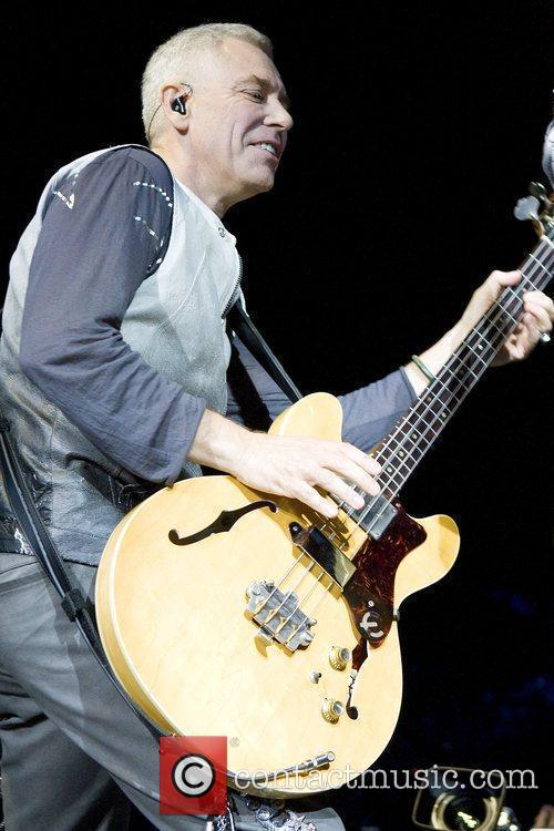 Adam Clayton U2 performing live in concert at...