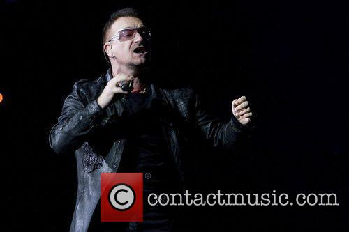 U2 performing live in concert at the Rose...