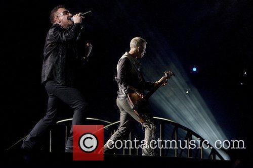 Bono and Adam Clayton 3