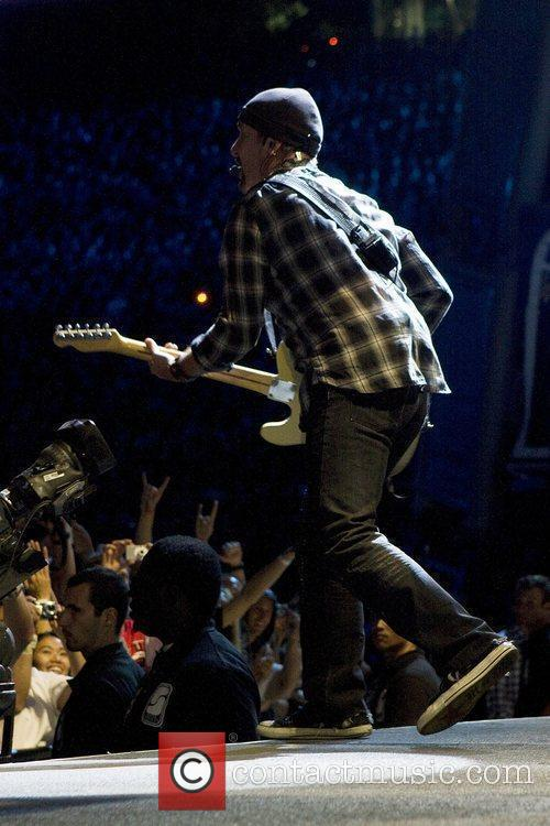 The Edge U2 performing live in concert at...