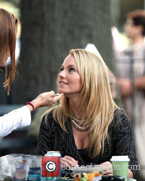 Becki Newton gets her make-up touched up on...