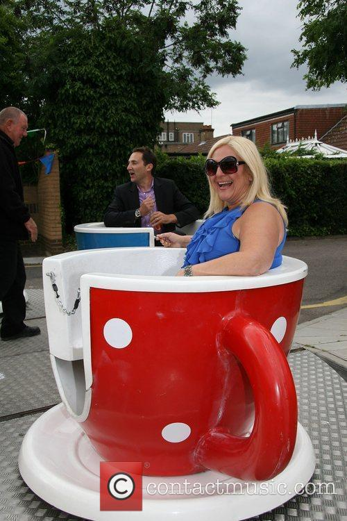 Vanessa Feltz enjoys a fairground ride during an...
