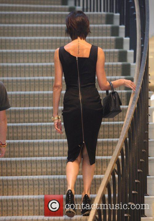 Victoria Beckham, Wearing A Black Zib Back Dress and Walks Up The Stairs Of Barneys New York In Beverly Hills Where She Spent An Hour Of Shopping 4