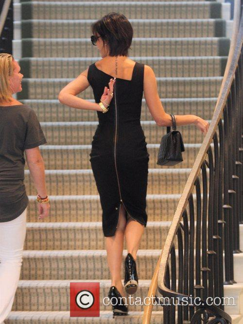 Victoria Beckham, Wearing A Black Zib Back Dress and Walks Up The Stairs Of Barneys New York In Beverly Hills Where She Spent An Hour Of Shopping 2