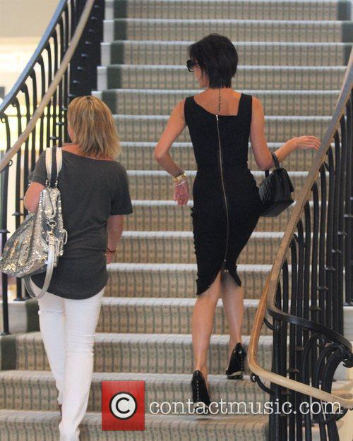 Victoria Beckham, Wearing A Black Zib Back Dress and Walks Up The Stairs Of Barneys New York In Beverly Hills Where She Spent An Hour Of Shopping 5