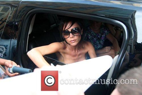 Victoria Beckham signs autographs for fans outside ABC...