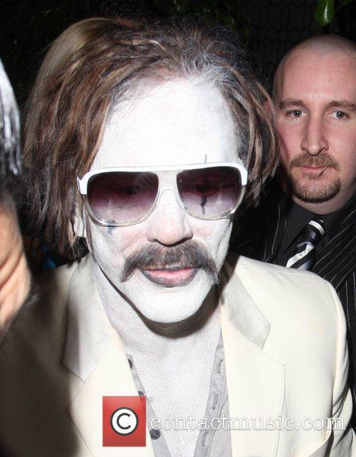 Mickey Rourke dressed as the Joker outside Voyeur...