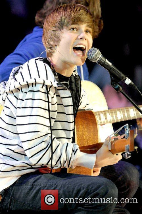 justin bieber on stage singing. As if Justin#39;s natural singing