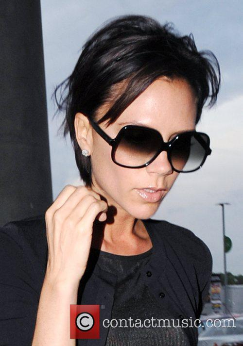Victoria Beckham arrives at the Wembley Stadium carrying...