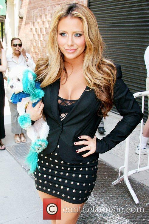 Aubrey O'Day with her dog, Ginger, outside Fox...