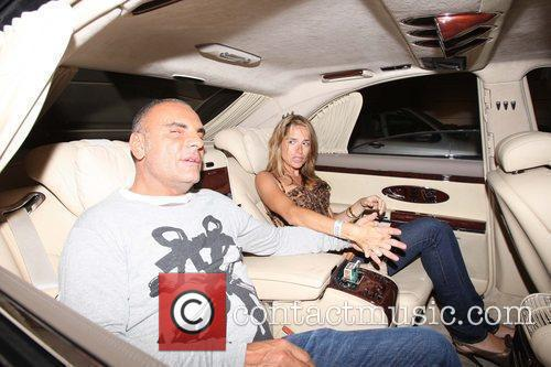 Designer Christian Audigier holds hands with wife Ira...