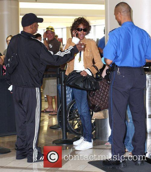 Whitney Houston arriving at LAX airport