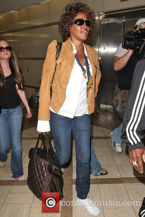 Whitney Houston arriving at LAX airport to catch...