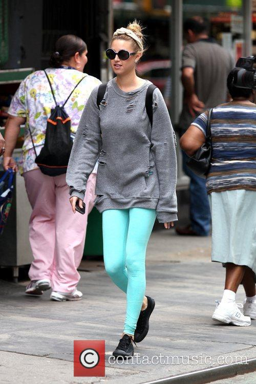 Whitney Port dresses for comfort while out and...