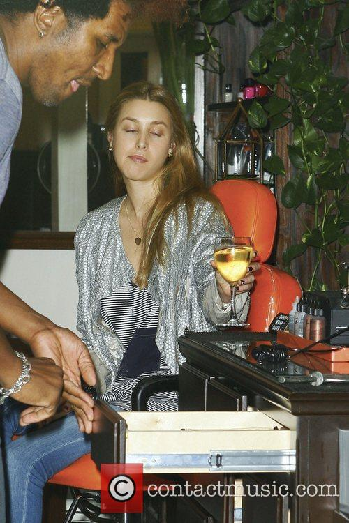 Whitney Port drinking wine as she visits TRUST...