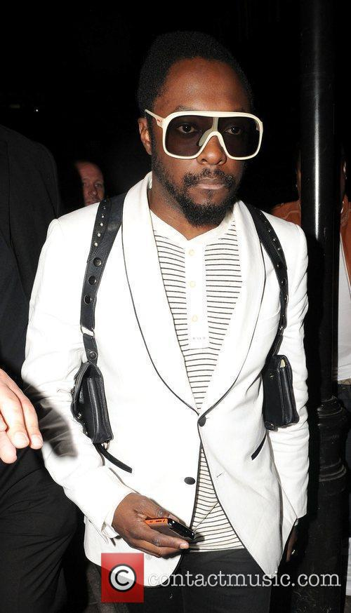 Leaves Funky Buddha nightclub wearing white sunglasses