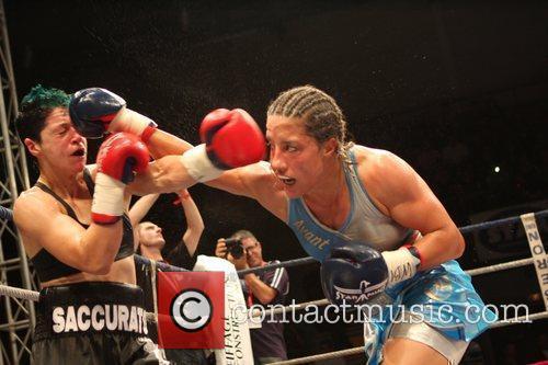Myriam Lamare of France (blue) v Ann Marie...