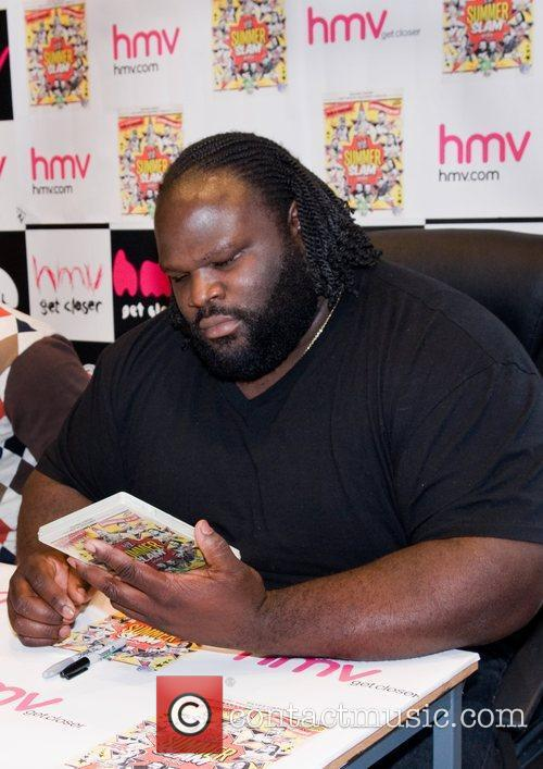 WWE Superstar Mark Henry meets fans and signs...