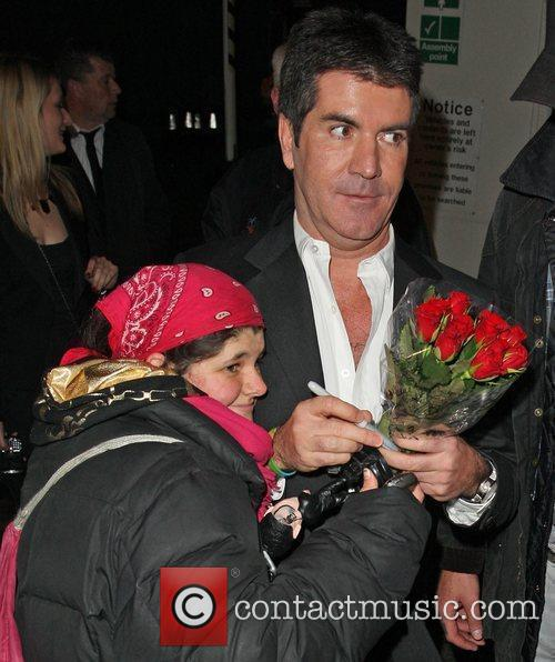 'Celebrity Hugger' Tania McIntosh gives Simon Cowell some...