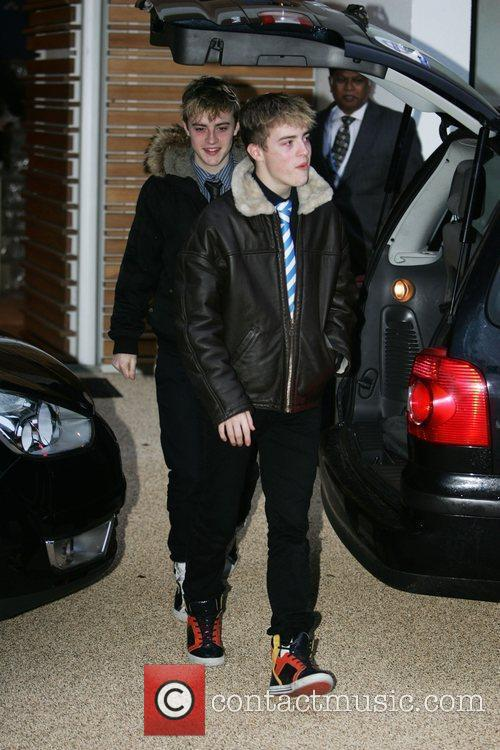 Leaving the 'X Factor' house on the day...