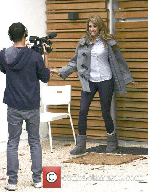 Is filmed as she leaves the X Factor...