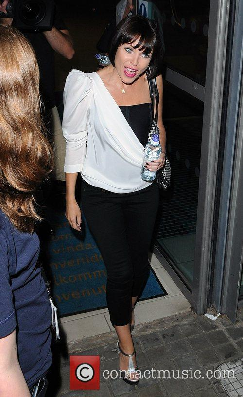 Dannii Minogue is approached by photographers and fans...