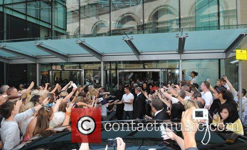 Simon Cowell is surrounded by fans as the...