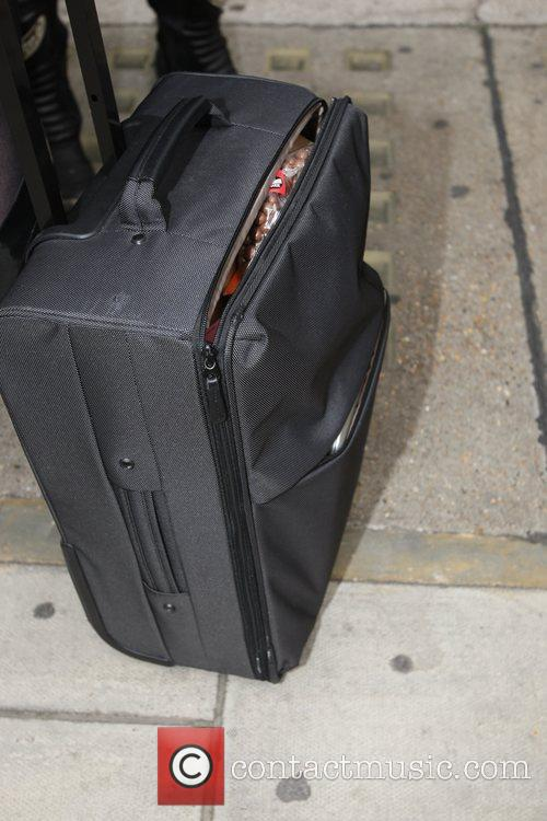 Pregnant Zoe Ball's suitcase is open to reveal...