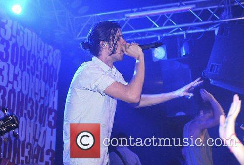Nathaniel Motte of 3OH!3 performing on stage at...