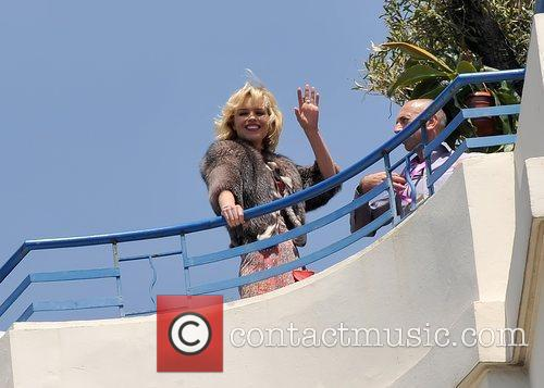 Eva Herzigova modeling on the roof of the...