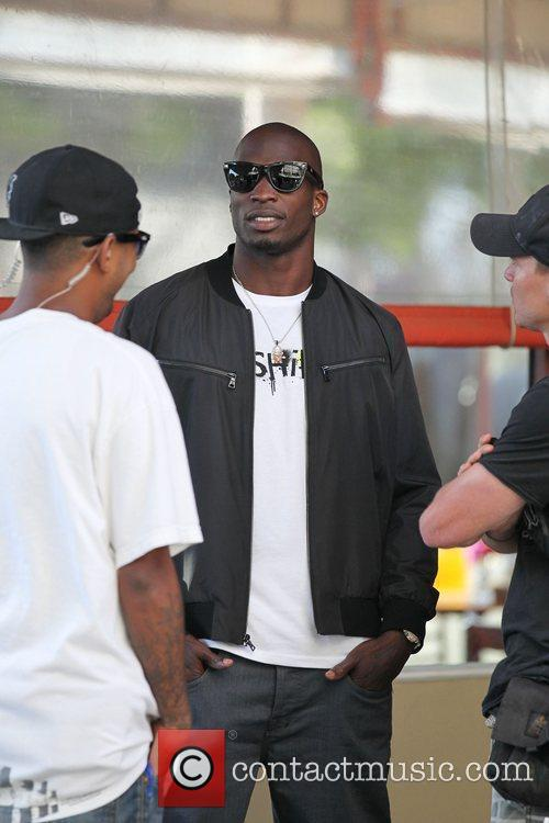 Chad Ochocinco standing outside the Newsroom Cafe on...