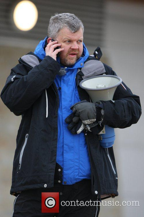 Adrian Chiles gets ready to help fellow presenter...