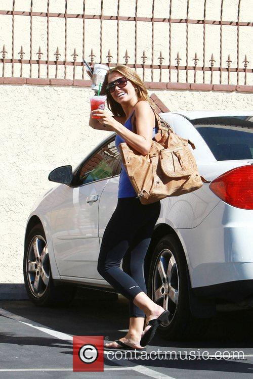 Arrives at a dance studio to rehearse for...