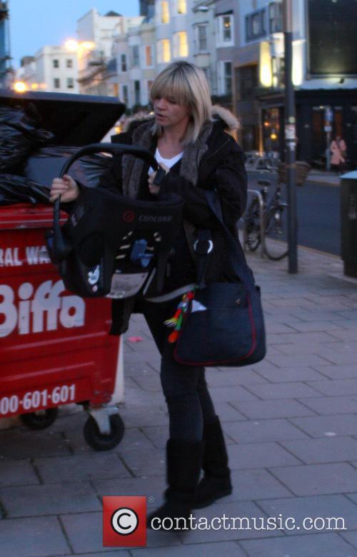 ***Exclusive***  Zoe Ball picks up her baby...