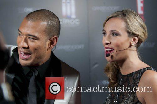 E! Entertainment hosts Michael Yo and Cristina Gibson...