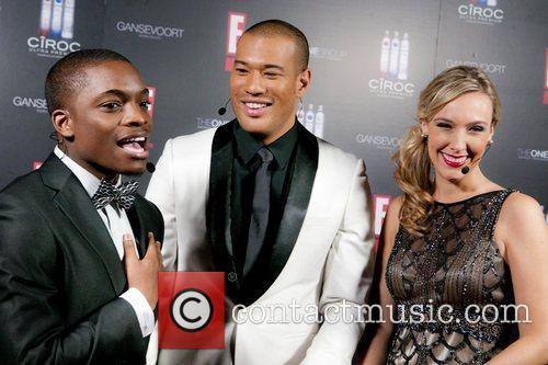 Guest (L) being interviewed by E! Entertainment hosts...