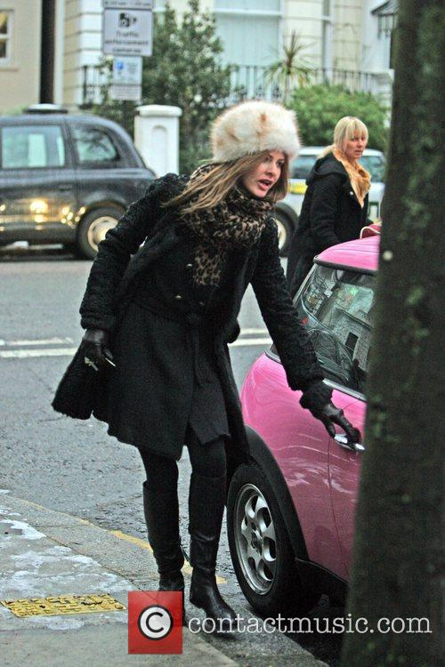 Trinny Woodall wrapped up an a warm coat...