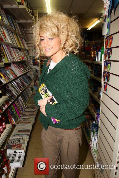 X Factor finalist Katie Waissel stops to buy...