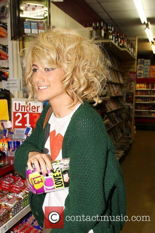 X Factor finalist Katie Waissel buys a copy...