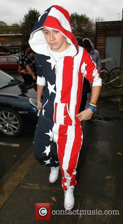 Arrives for rehearsals wearing the latest fashion item,...