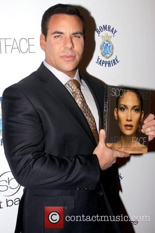 Scott Barnes holding his new book 'About Face'...