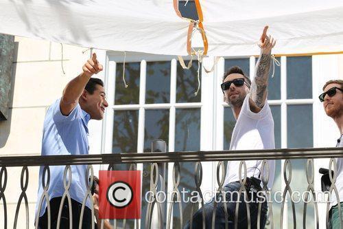 Mario Lopez and Adam Levine Adam Levine of...
