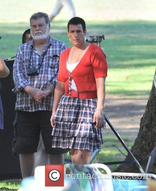 Adam Sandler dressed as a woman in a...