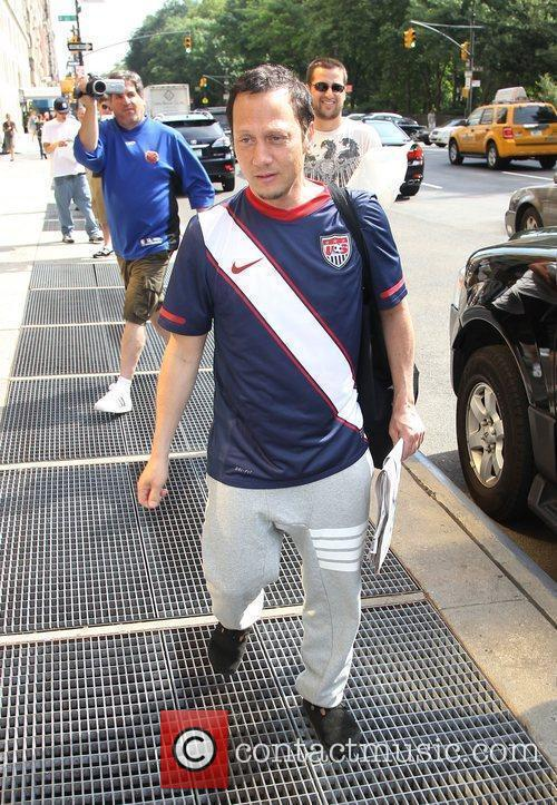 Leaving his hotel, wearing a USA football shirt.