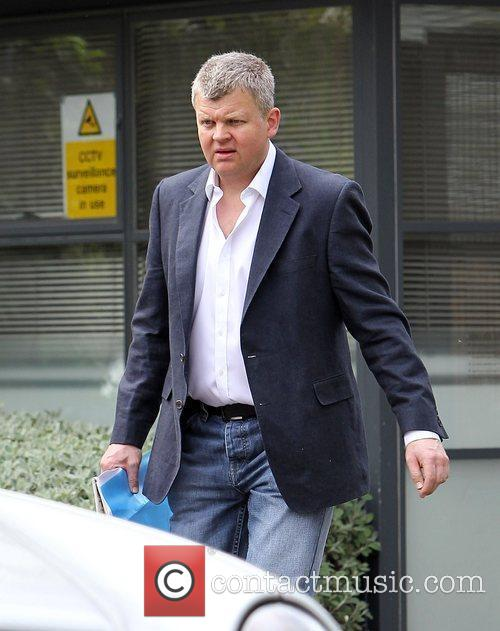 Adrian Chiles leaving his home on his way...