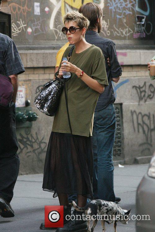Model and actress Agyness Deyn takes her dog...