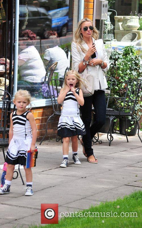 Is seen seen running errands with her two...