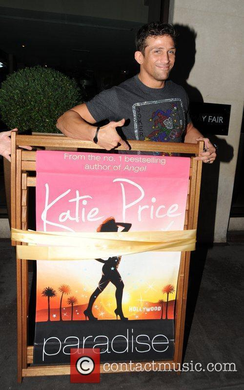 Alex Reid holding a Katie Price promo for...